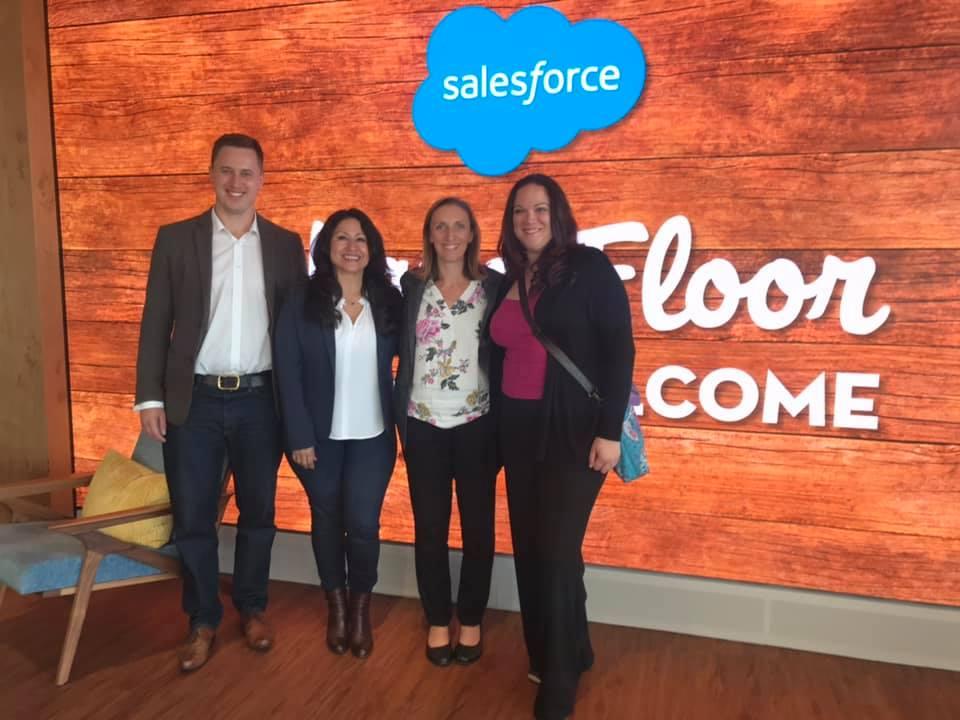 Group of people standing on the Salesforce Ohana floor